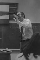 Photograph of Nouwen giving lecture at Yale University
