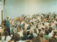 Photograph of Nouwen in crowded lecture hall