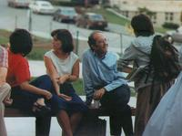 Photograph of Nouwen talking with students