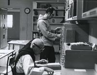 Photograph of Nouwen in the library at the Abbey of the Genesee