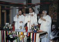 Photograph of Nouwen celebrating Eucharist