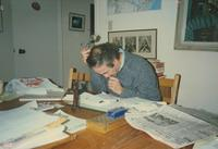 Photograph of Nouwen reading mail