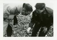 Photograph of Nouwen with Joe Collins on beach