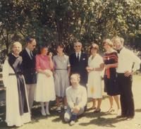 Photograph of Nouwen with family and Fr. John Eudes Bamberger