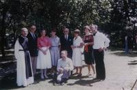 Photograph of Henri Nouwen with family and Fr. John Eudes Bamberger